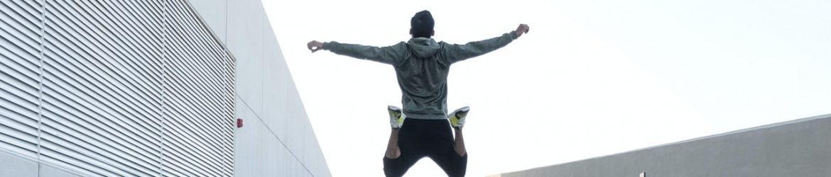 cropped-man-in-gray-hoodie-jump-with-open-arms-1432580.jpg